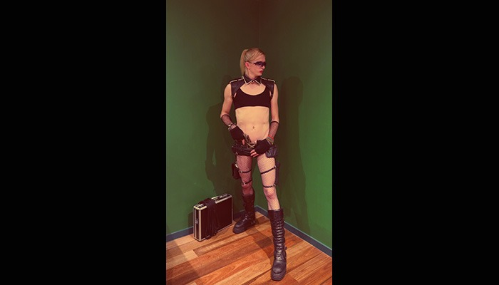 Fetish House Apprentice Mistress Inara wearing black crop top and short shorts with long knee high boots